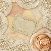 Rose and vintage lace — Stock Photo