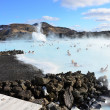 People bathing in the Blue Lagoon in Iceland — Stock Photo #30866815