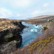 Hraunfossar lavwaterfalls falling with blue water on Iceland — Stock Photo #31166087