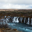 Hraunfossar lava waterfalls falling with blue water on the Iceland — Stock Photo