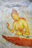 Sigiriya maiden With Flowes painting on the wall — Stock Photo