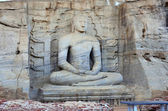 Grey and stone buddha sitting in Polonnaruwa — Stock Photo