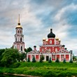 Red church on coast of the lake - Stock Photo