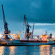 Shipyard with ship at dusk time - Stock Photo