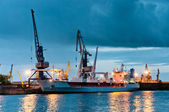 Shipyard with ship at dusk time — Stock Photo