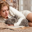 Stock Photo: Pretty and cute womreading book