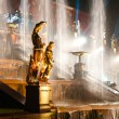 Sculptures with fountain on background - Stock Photo