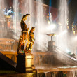 Stock Photo: Sculptures with fountain on background