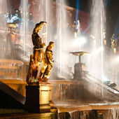 Sculptures with fountain on background — Stock Photo