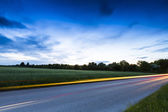 Long exposure highway blue hour sunset clouds sky road traffic autoroute — Stock Photo