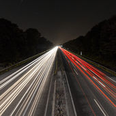 Long time exposure freeway cruising car light trails streaks of light speed highway Aix-la-Chapelle — Stock Photo