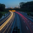 Long time exposure freeway cruising car light trails streaks of light speed highway tunnel — Stock Photo #30169675