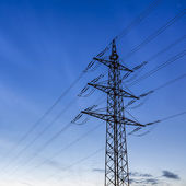 High voltage electricity pylon sunset blue hour energy power electricity dusk — Stock Photo