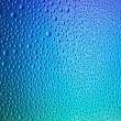 Water drops spectral blue green colors gradient rainbow colorful beading lotuseffekt tau sealing — Stock Photo