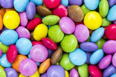 Chocolate lentils smarties candy chocolate confectionery multicolored colorful halloween birthday — Stock Photo