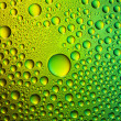Water drops spectral green yellow colors gradient rainbow colorful beading lotuseffekt tau sealing — Stock Photo