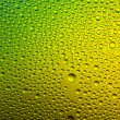Water drops spectral color yellow green gradient rainbow colorful beading lotuseffekt tau sealing — Stock Photo