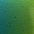 Water drops spectral green yellow blue gradient rainbow colorful beading lotuseffekt tau sealing — Stock Photo #35015153