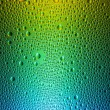 Water drops spectral gradient blue green yellow rainbow colorful beading lotuseffekt tau sealing — Stock Photo #35015471