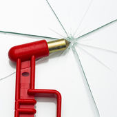 Emergency hammer red rescue disk hammer broken glass splinter danger notfal bus beating thorn window — Stock Photo