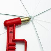 Emergency hammer red rescue disk hammer broken glass splinter danger notfal bus beating thorn window — Stock Photo