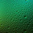 Waterdrops spectral gradient green nature black colors rainbow colorful beading lotuseffekt tau sealing — Stock Photo
