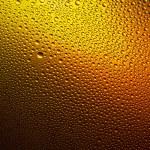 Water drops spectral orange yellow gold colors gradient rainbow colorful beading lotuseffekt tau sealing — Stock Photo #35024185