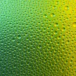 Waterdrops spectral gradient green gold yellow nature colors rainbow colorful beading lotuseffekt tau sealing — Stock Photo #35032929