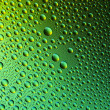 Water drops spectral gradient nature green gold yellow colors rainbow colorful beading lotuseffekt tau sealing — Stock Photo #35033281