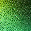Water drops spectral gradient nature green gold yellow colors rainbow colorful beading lotuseffekt tau sealing — Stock Photo