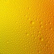 Water drops spectral gradient orange yellow gold beer sun colors rainbow colorful beading lotuseffekt tau sealing — Stock Photo