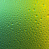 Waterdrops spectral gradient green gold yellow nature colors rainbow colorful beading lotuseffekt tau sealing — Stock Photo