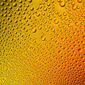 Water drops spectral gradient orange yellow sun summer gold colors rainbow colorful beading lotuseffekt tau sealing — Stock Photo