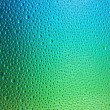 Water drops spectral gradient blue green ocean colors rainbow colorful beading lotuseffekt tau sealing — Stock Photo
