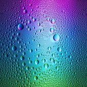 Waterdrops spectral gradient blue purple green ocean colors rainbow colorful beading lotuseffekt tau sealing — Stock Photo