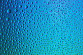 Waterdrops spectral gradient blue ocean green colors rainbow colorful beading lotuseffekt tau sealing — Stock Photo