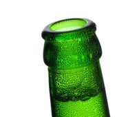 Beer bottle bottleneck bubbles condensation dripping green chilly dew brewery disco summer party — Stock Photo