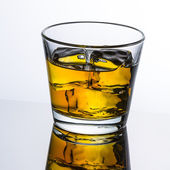 Whiskey glass reflection ice drink bourbon rocks alcoholic alcohol scotland spirit tennessee — Stock Photo