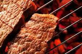 Steak meat on Barbecue grid — Stock Photo