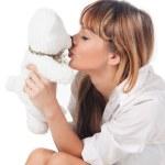 Woman kissing her teddy bear — Stock Photo