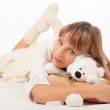 Woman playing her teddy bear — Stock Photo
