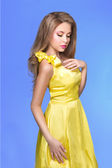 Trendy young woman in funky yellow dress — Stock Photo