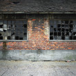Stok fotoğraf: Brick wall with broken windows