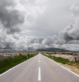 Open road and stormy clouds — Stock Photo