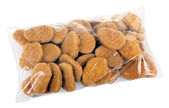 Pack with ready-to-cook meat nuggets isolated on white backgroun — Stock Photo