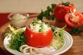 Stuffed tomato with squid, corn, peas and cream of tartar — Stock Photo
