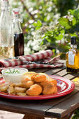 Summer time. Table with fried chicken, salad and vegetables — Stock Photo