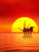 Oil platform in the sunset — Stock Photo