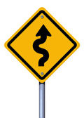 Road sign winding road — Stock Photo
