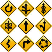 Rhombic yellow road signs with arrows directions — Stock Photo